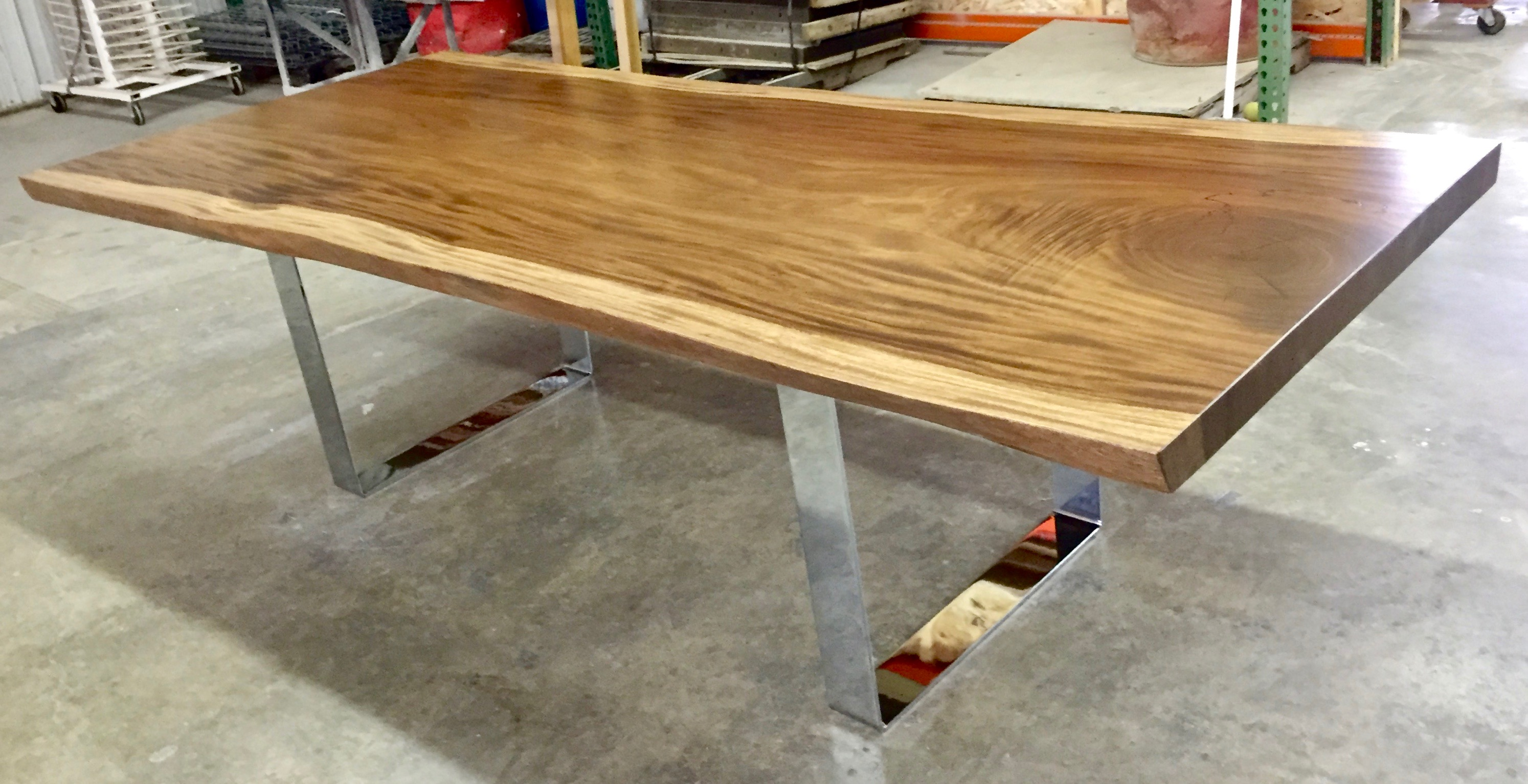 Live edge monkeypod slab with chrome U legs